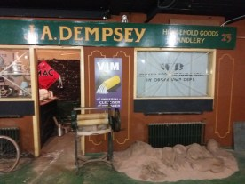 Dempsy's shop, double fronted but half is closed and half is open and full of crockery.