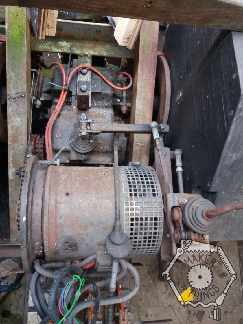 The electric motor mounted in front of the transaxle with the gear change lever mounted to the right. The image shows the convoluted linkage between the gear stick and the gearbox.