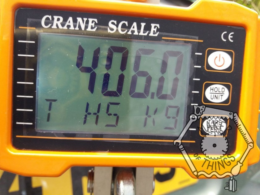 The crane scale showing a weight of 406kg.