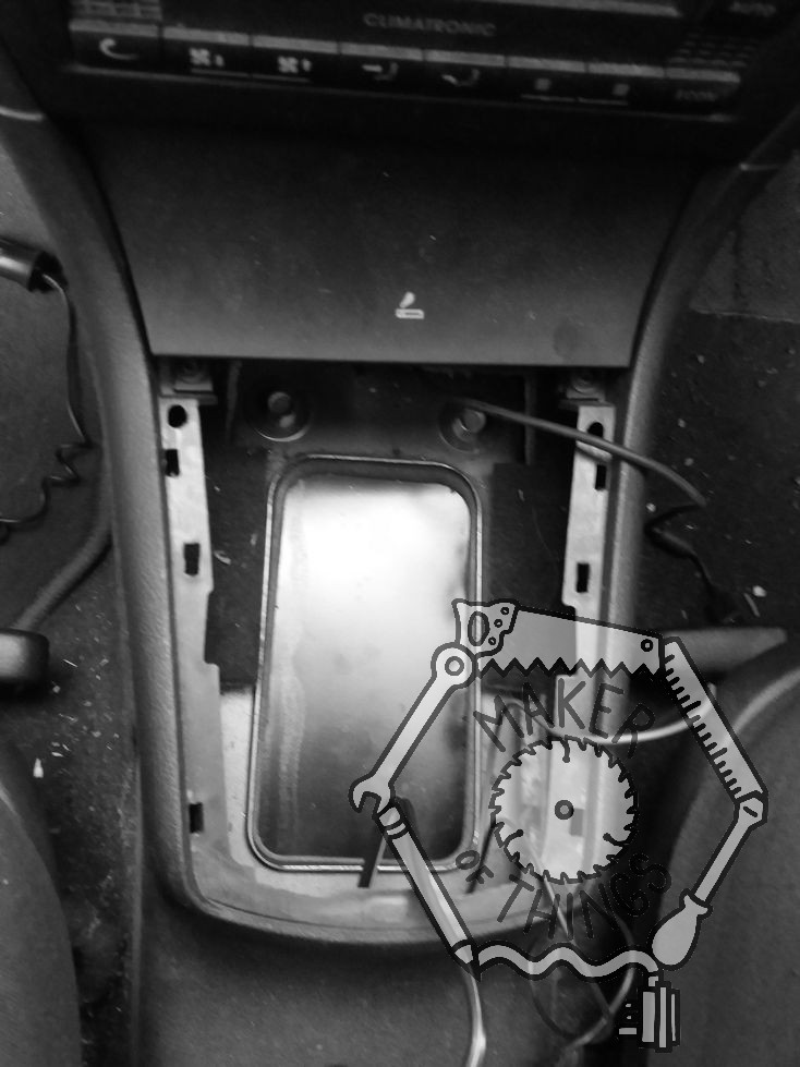 The hole in the gear shift tunnel seen from above with the black steel cover bolted in place to close the hole.