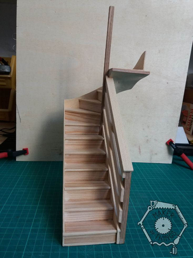 Front side view of the staircase with hand rail fitted. A simple 1970s style of three 'horizontal' boards following the slope of the stairs.