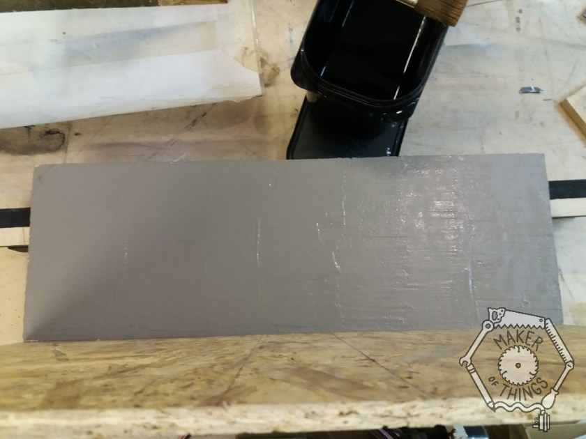 A section of the OSB backdrop plaster textured and painted grey.