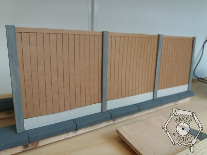 The same three fitted fence panels seen from a different direction.