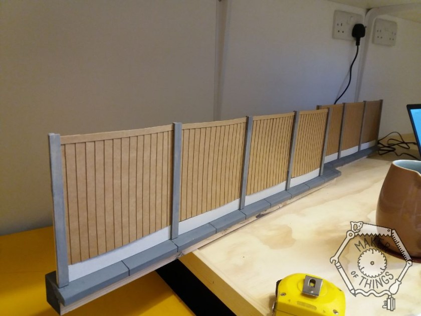 Both lengths of copings and fencing assembled with four and three panels respectively.