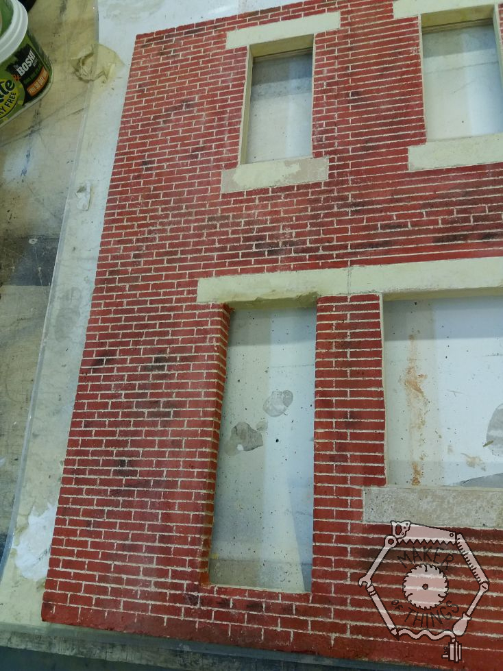 The completed left side of the brickwork showing how the brick courses fit in with the window sill and lintel heights, and also wraps around the door reveal.