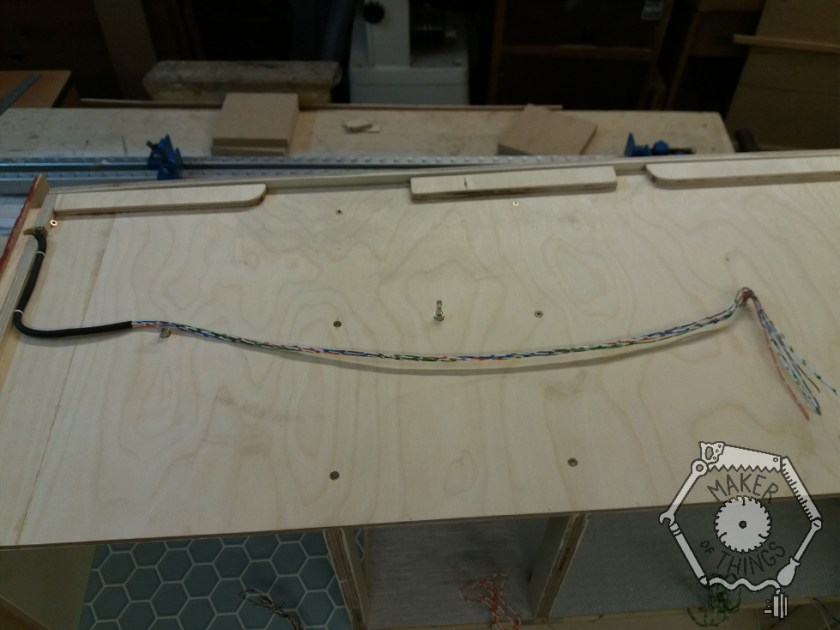 The top of the dolls house showing a multi core wire leading to the three lighting sockets.