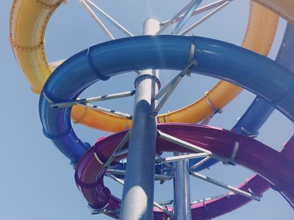 looking up at colourful water slides