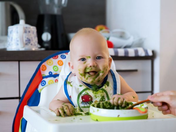 messy baby with food on face