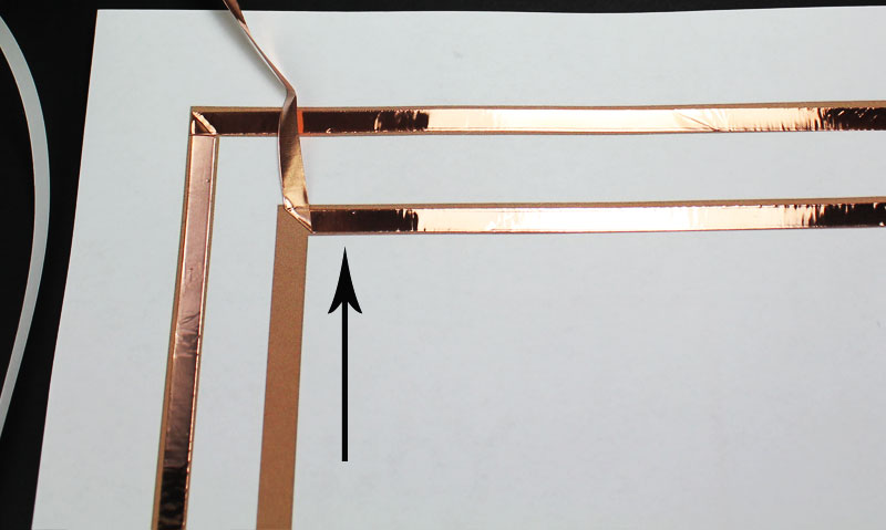 Next, fold the copper tape at 45 degree angle up.