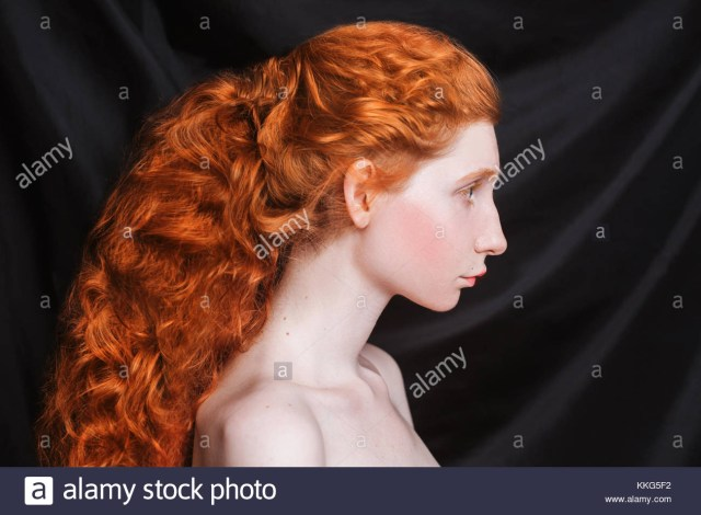 Makeup For Red Hair And Brown Eyes Woman With Long Curly Red Hair Gathered In Ponytail On Black Stock