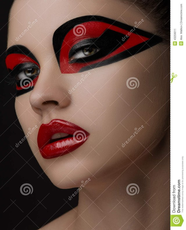 Red And Black Eye Makeup Red Lips Black Makeup On The Eyes Of The Mask Women Beauty Stock