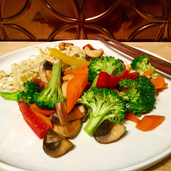 Vegetable Stir Fry with Cashews - a simple super healthy meal with broccoli, peppers, carrots, mushrooms, cashews and rice or noodles