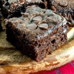 A piece of Chocolate Banana Snack Cake with chocolate chips on top.
