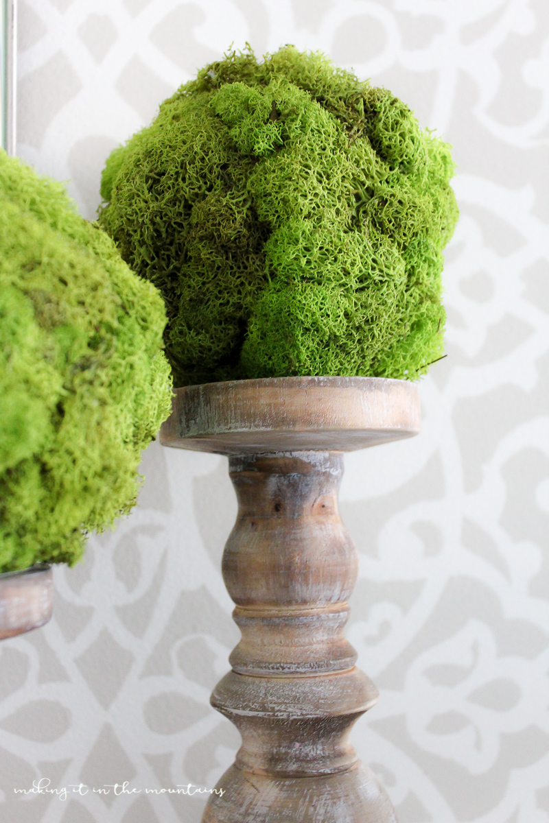 They may have taken just minutes to make, but these pretty DIY moss topiary balls sure to do bring a beautiful touch of nature to any space!