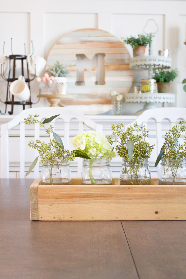 There's no simpler way to welcome Spring than with some lovely flowers in mason jars! This simple Spring centerpiece is the perfect addition to any table!