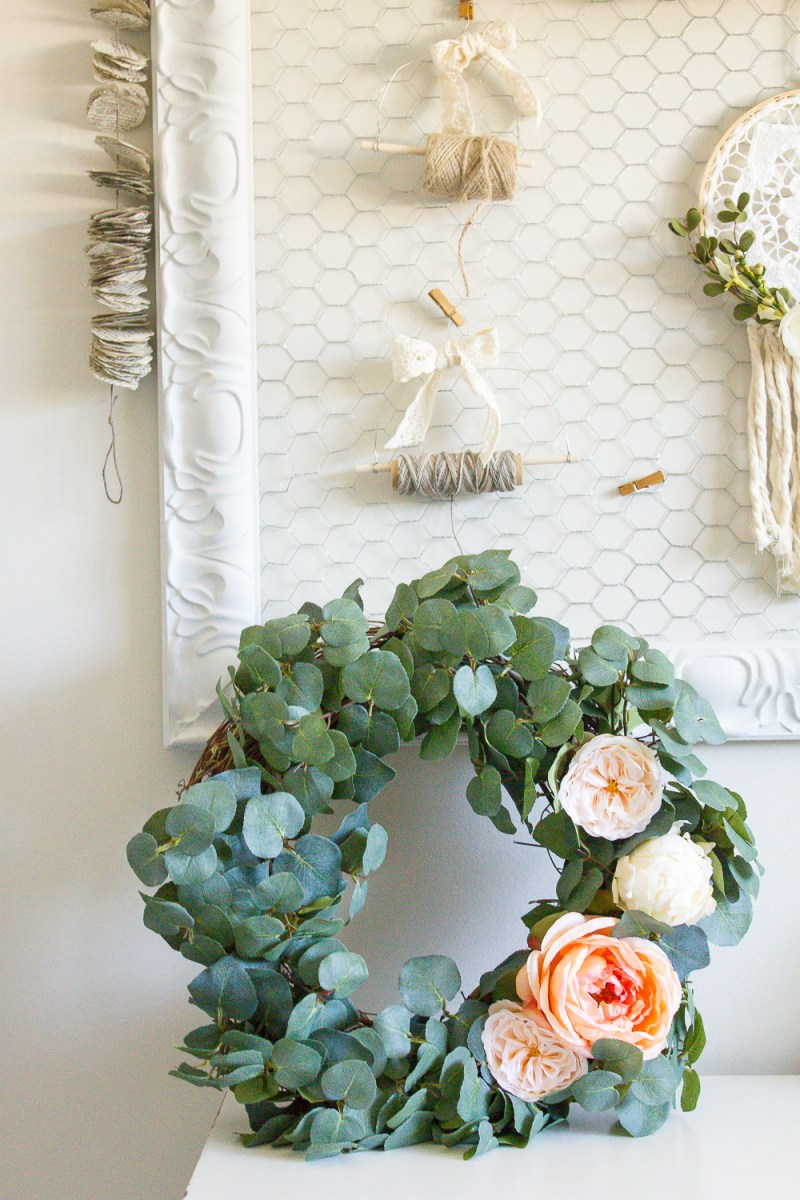 This DIY eucalyptus wreath was so simple to make and the soft colours will look beautiful hanging on our door all Summer long! | www.makingitinthemountains.com