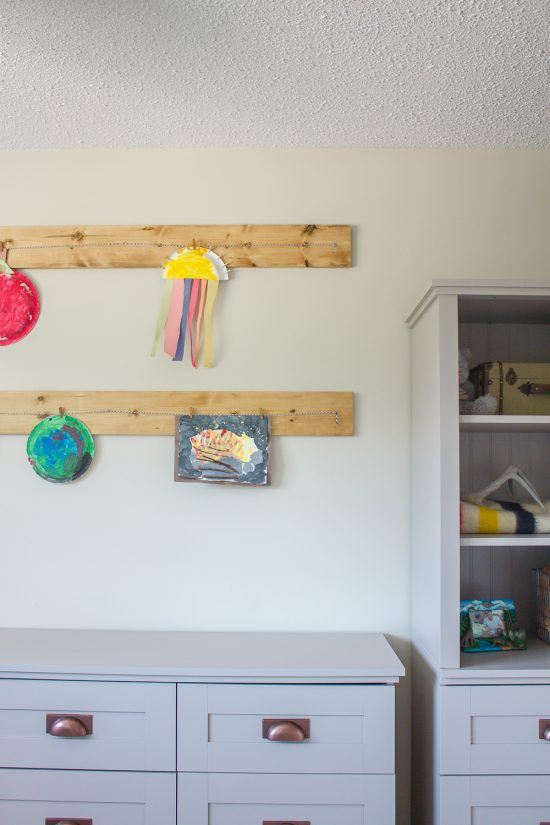 This DIY art hanger is the perfect way to display your children's artwork and the clips make is so quick and easy to change things out whenever they choose! Even better, it took just minutes to whip up!