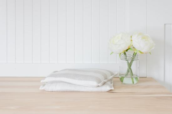 linen rice bag, white flowers, white beadboard, butcher block
