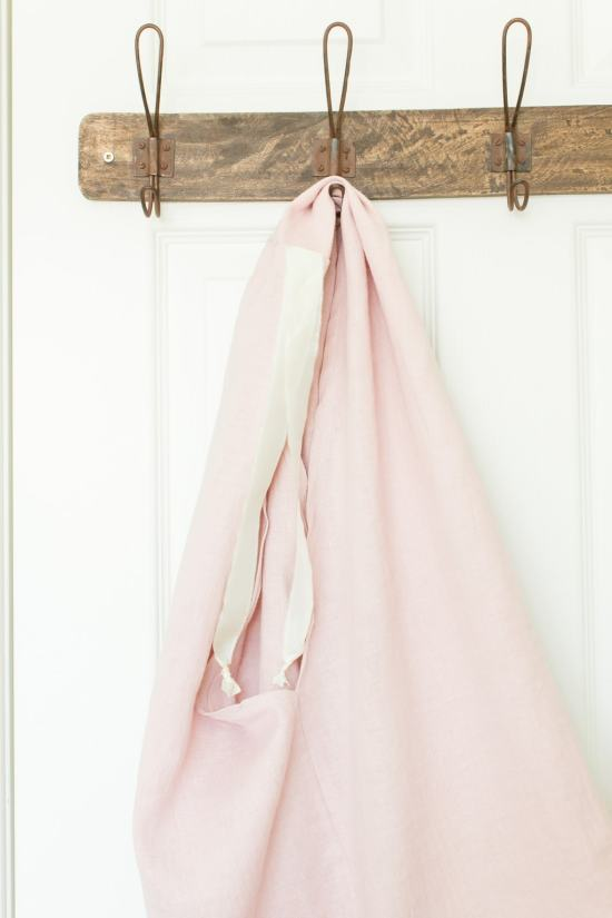 linen tote hanging on hook