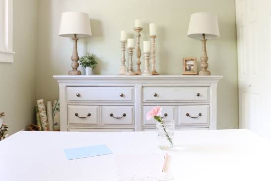 pen, paper, desk, mason jar flower, white dresser, wood candlesticks
