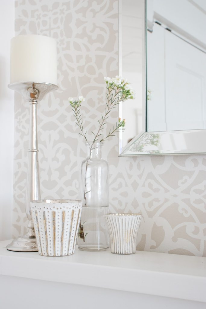stencil wall, bottle vase, mercury glass candles