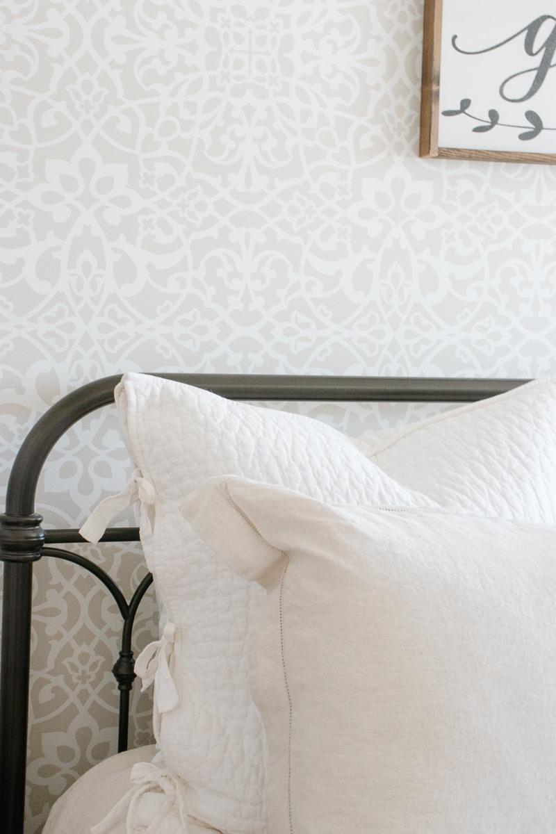 linen bedding, iron bed, stencil wall