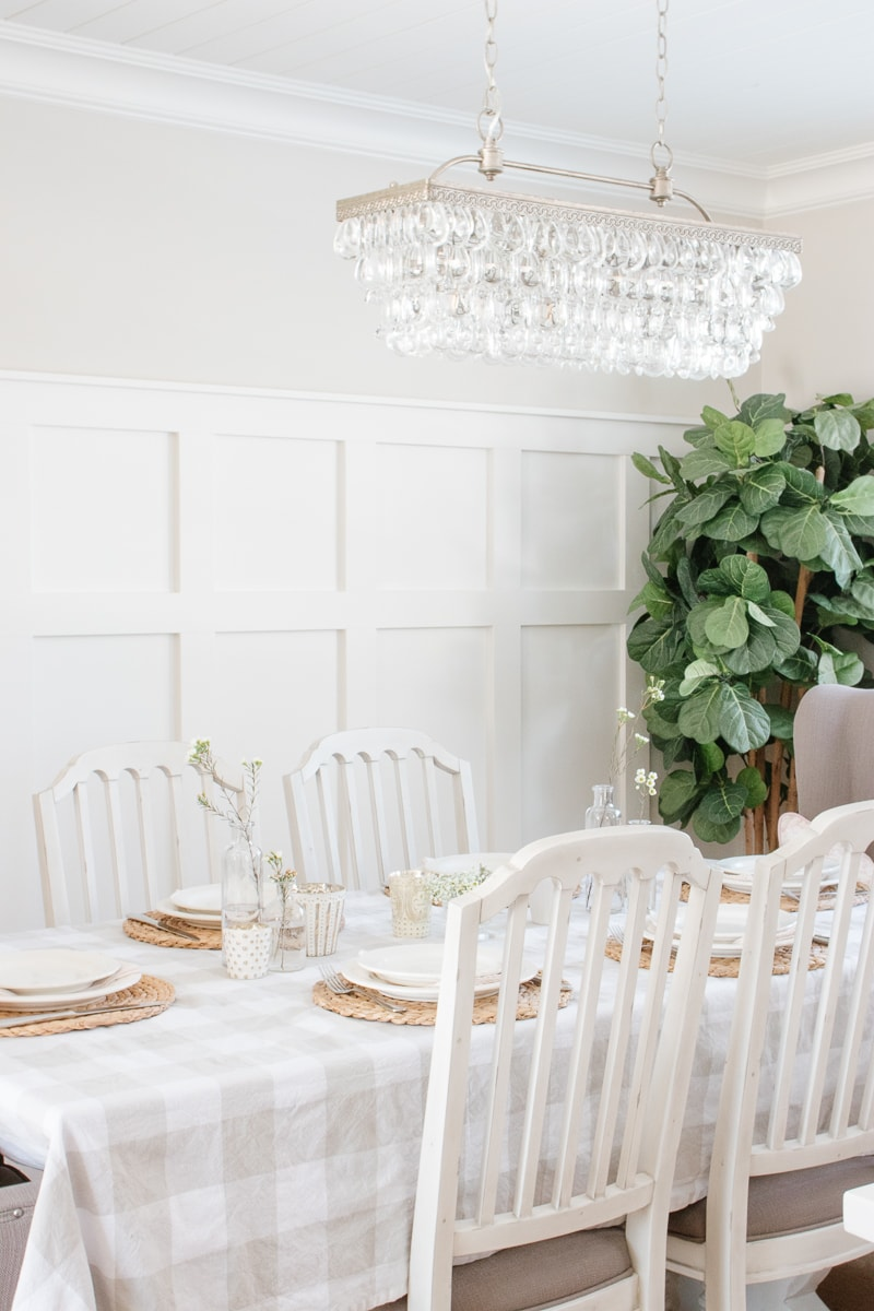 neutral spring table setting, white dishes, buffalo check tablecloth, board and batten wall