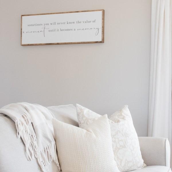 sofa, fall pillows, wood sign