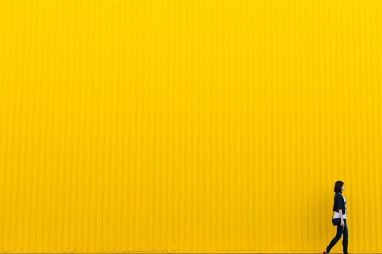 girl-in-front-of-yellow-wall