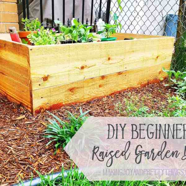 DIY Beginner Raised Garden Bed perfect for small yards and beginner gardeners. Easy DIY that can be done in an afternoon.