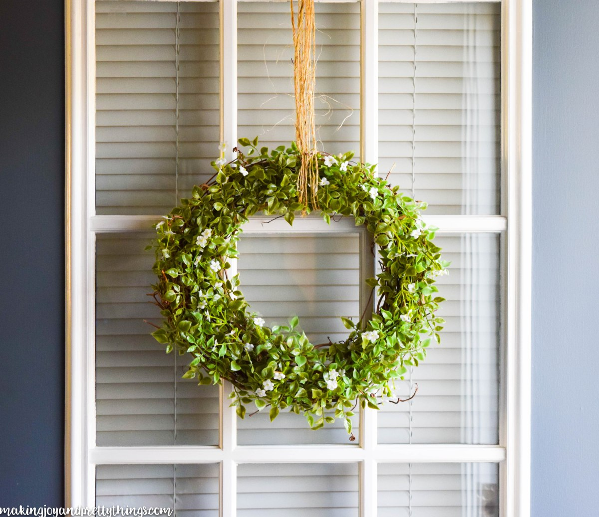 This simple farmhouse wreath is an easy DIY to add fixer upper and farmhouse style to your home. Easy to make and has a beautifully simple finish. Bring the farmhouse style home decor into your home