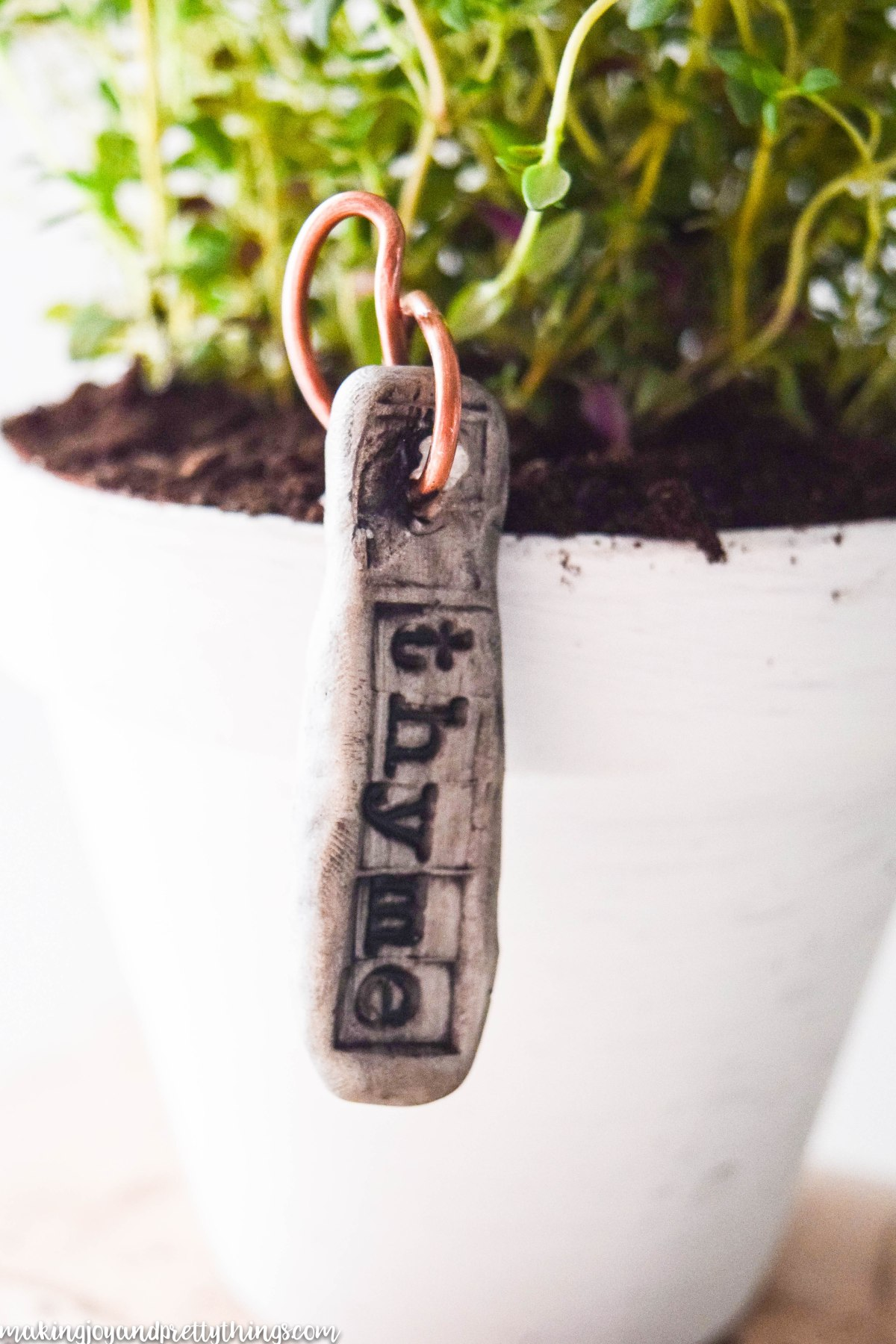 DIY Garden Markers using clay and copper wire.  Really adds rustic and farmhouse charm to plants.  Easy DIY plant markers perfect for herb garden, container garden or vegetable garden.