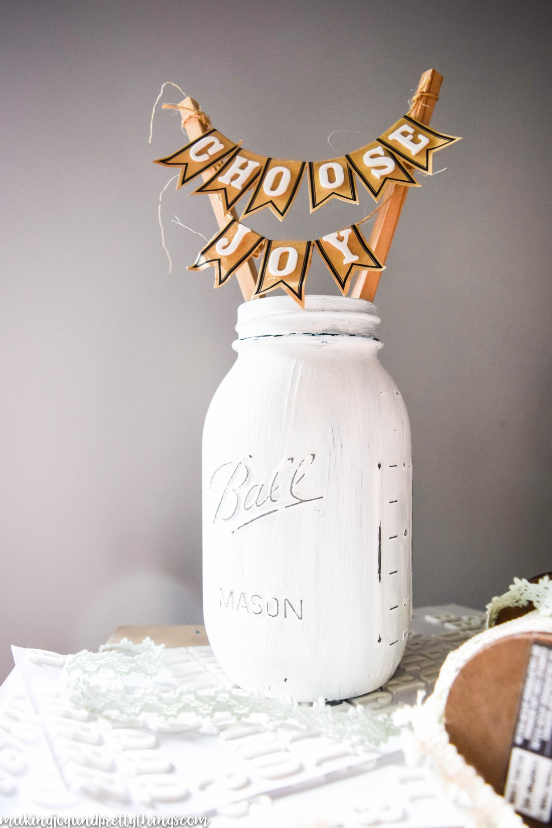 DIY farmhouse inspired mason jar display. Easy DIY craft to bring farmhouse style into your home decor. Budget friendly and sends great message.