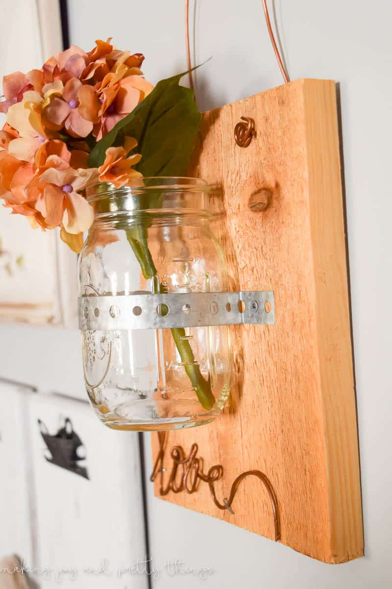 This Rustic Scrap Wood Hanging Mason Jar is a perfect DIY project to get the farmhouse and fixer upper look on a budget!