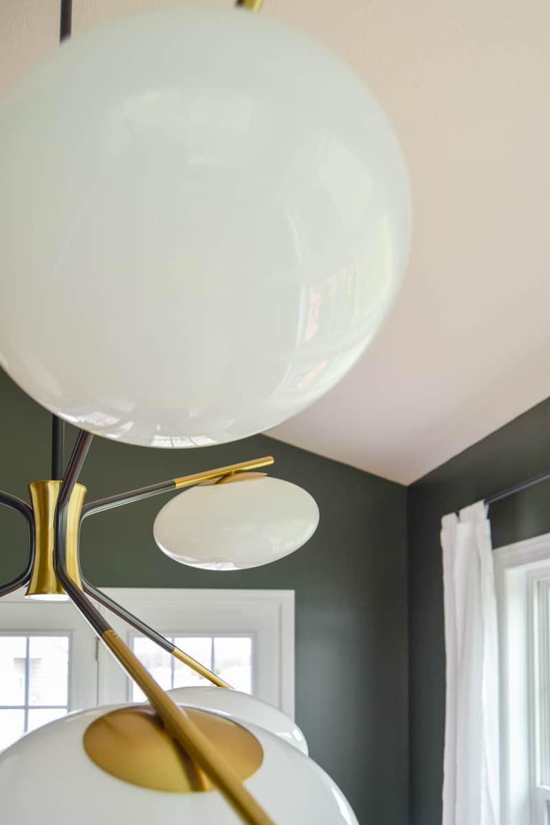 modern dining room reveal | mid-century modern dining room | dark paint | dining room ideas | dining room renovation | #diningroom #modern #diy #renovation #midcentury