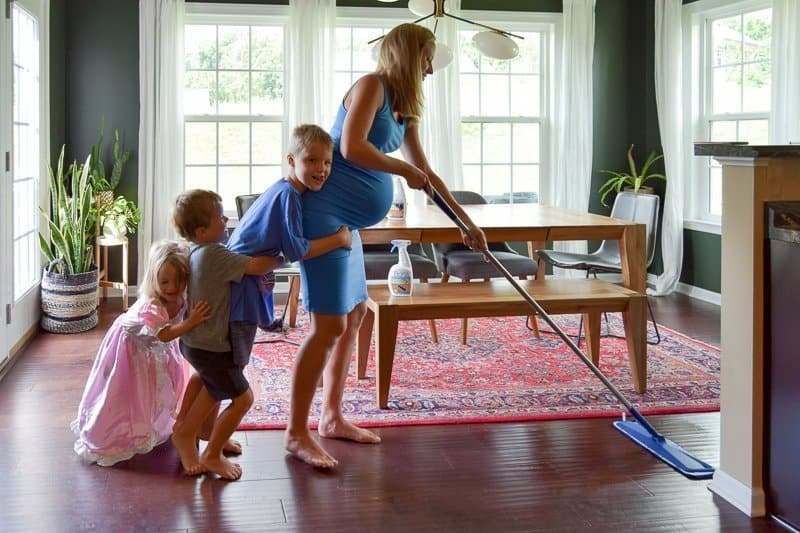 How to clean hardwood floors naturally with kids. This hardwood floor cleaner is gentle and effective at removing dust, dirt, and grime and is GREENGUARD GOLD certified so it's safe to use with kids and pets. Get a clean house with a residue-free cleaner that leaves hardwood floors looking like new. #bonaessentials #hardwoodfloors #hardwood #cleanhouse