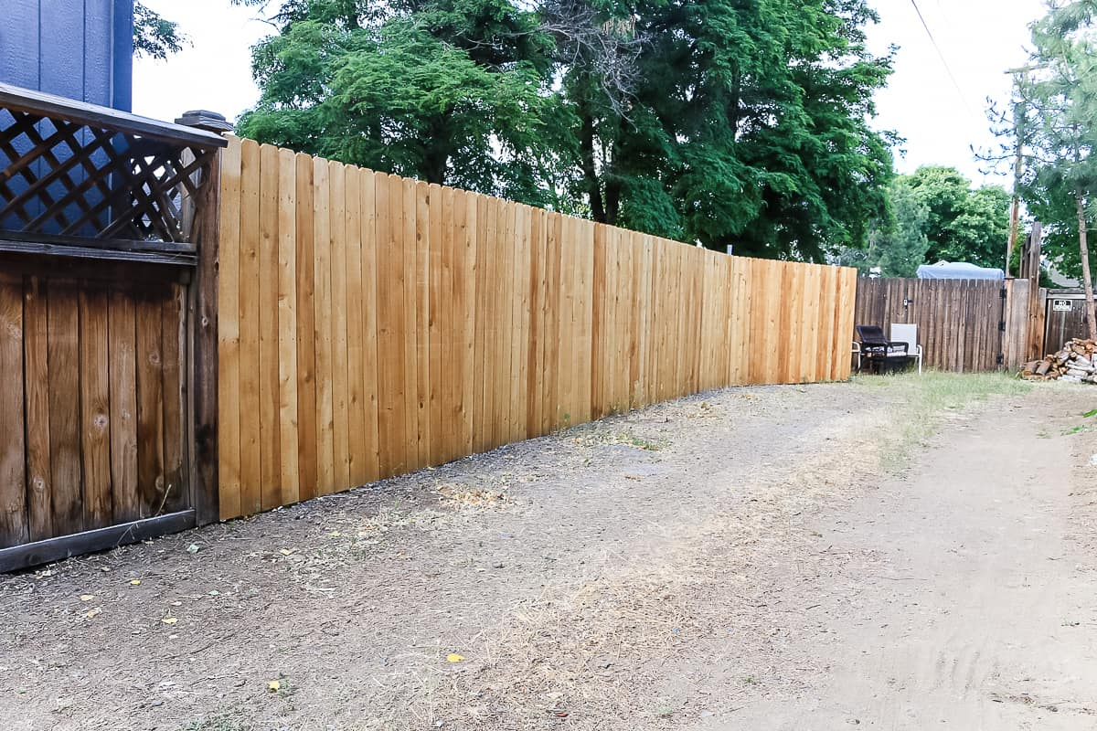 shows a wood fence in backyard