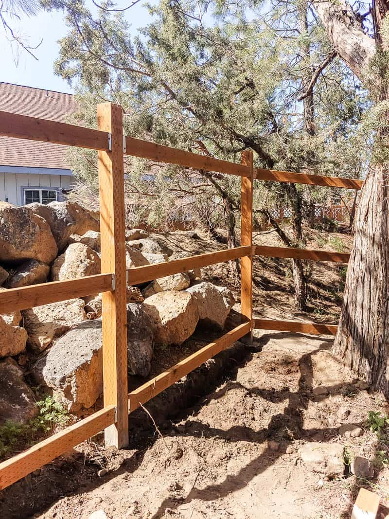 shows another angle of the framework for a fence