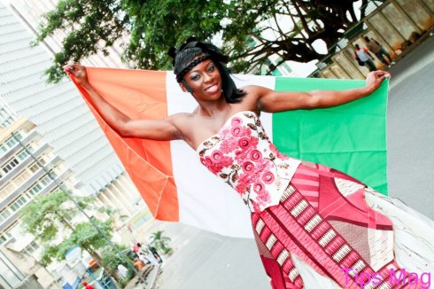 Ahouré posing with Ivorien flag (Photo credit: Tips Magazine Officiel)