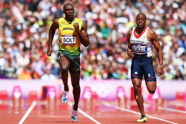 Dasaolu (Right) competes against Usain Bolt at the London 2012 Olympic Games (Photo Credit: Getty Images)