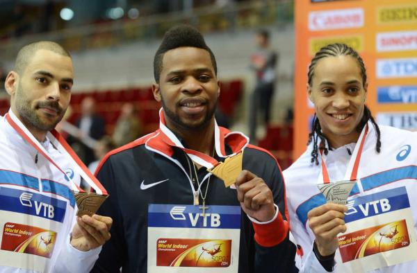Osaghae flanked by William Sharman of Great Britain and Pascal Martinot-Lagarde of France.  (Photo Credit: www.tc-management.com)