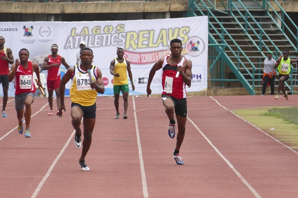 Team MoC's Hammed Yusuf (Right) slugs it out with a member of the Police relay team.