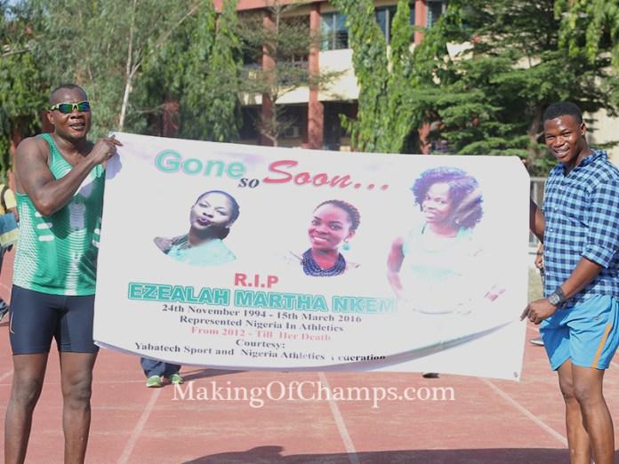 Deji Aliu and Fred Agbaje holding a banner in honour of Nkem Ezealah.