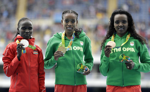 Almaz Ayana flanked by second placed Vivian Cheruiyot, and Bronze medallist Tirunesh Dibaba. (Photo Credit: AP Photo/David Goldman)