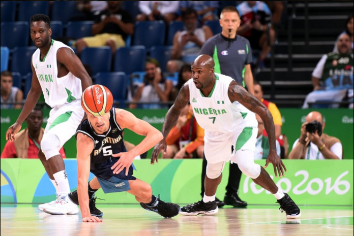 Ebi Ere and Manu Ginobli vying for the ball. Photo Credit: Getty Images