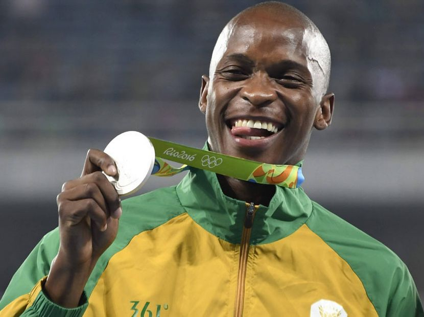 A happy Luvo Manyonga displaying his Silver medal during the medal ceremony at the Rio Olympics.