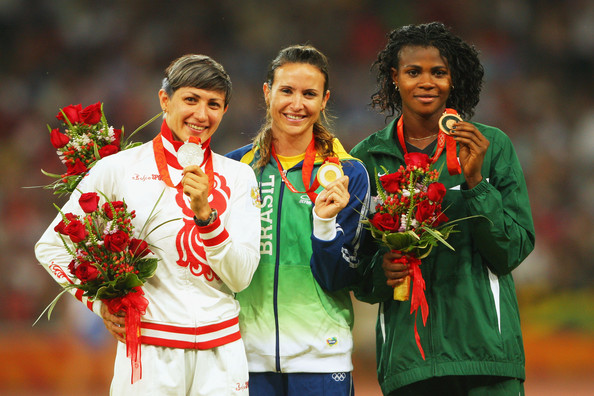 Brazil's Maurren Maggi is flanked by Tatiana Lebedeva (L) and Blessing Okagbare (R) on the podium for the women's Long Jump event at the Beijing 2008 Olympics. Photo Credit: Getty Images