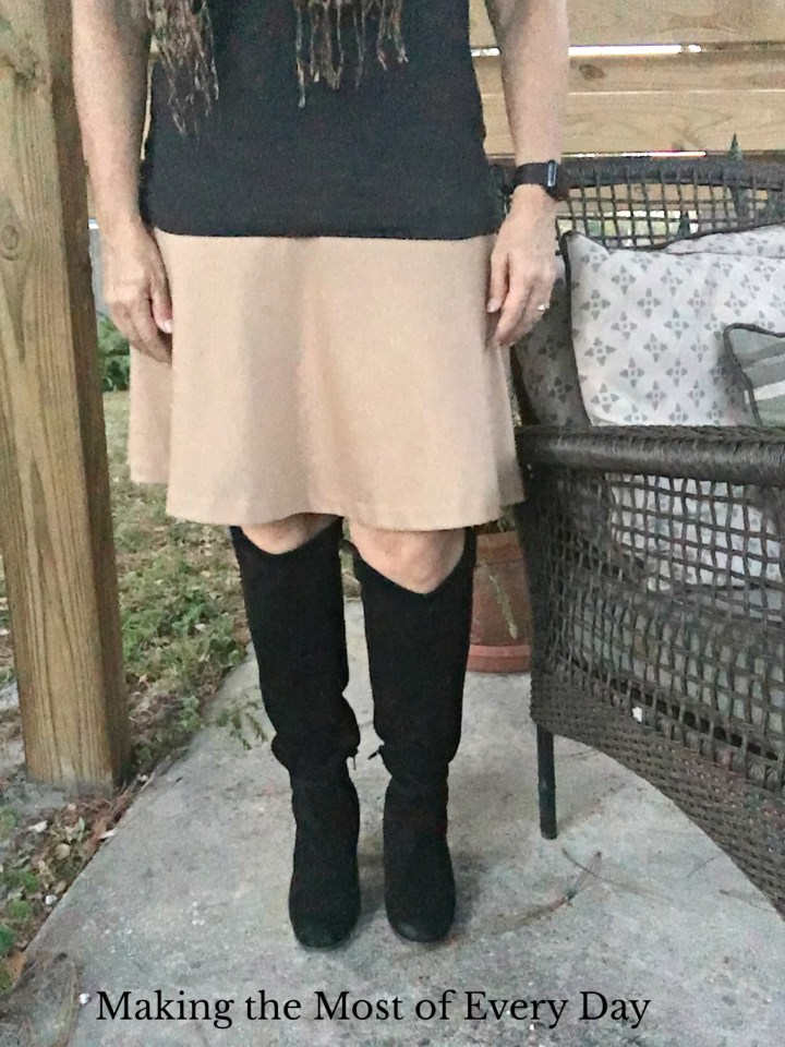 Fall find: tall black boots! Paired with tan and leopard.
