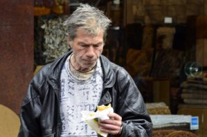 Salonika Man eating a cheese pie