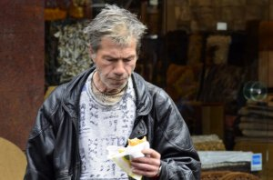 Man eating a cheese pie